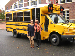 Student and mom with school bus