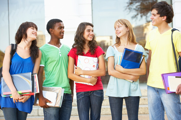 A group of happy students chatting